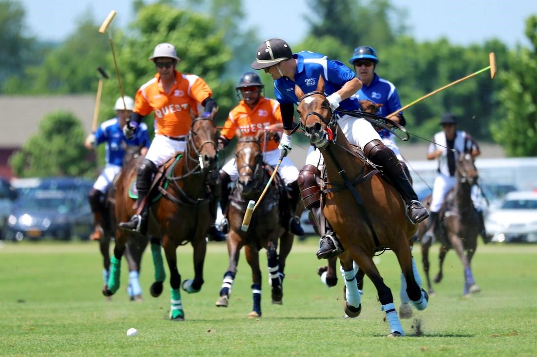 Polo players riding horses at Mashomack International Polo Challenge, Pine Plains, New York