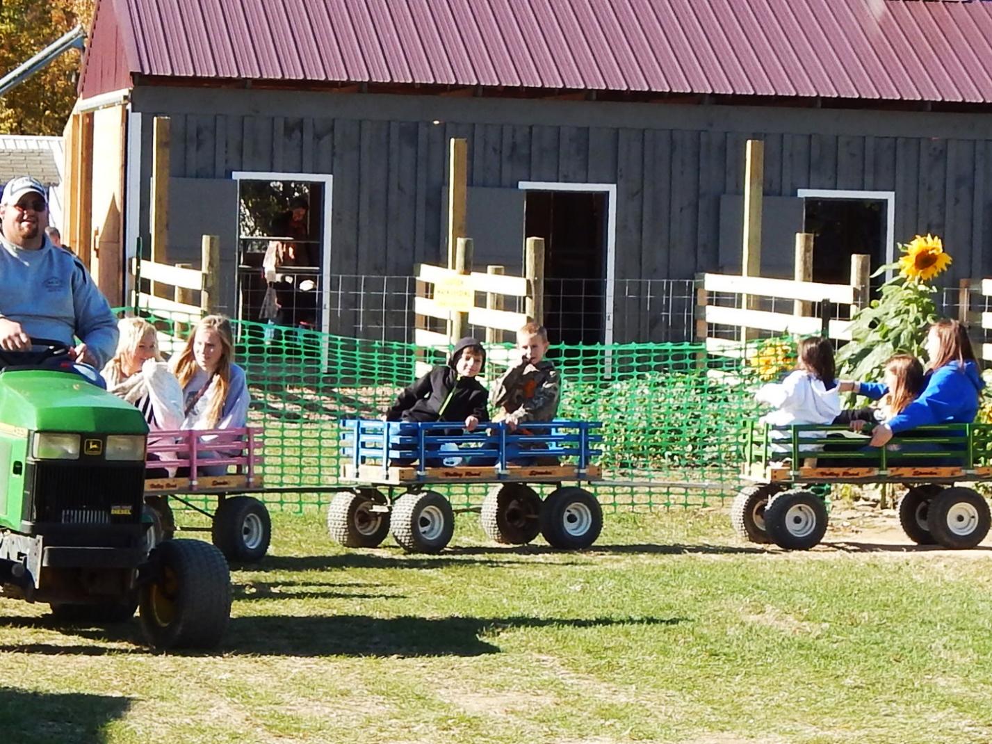 Kids riding wagons at Kesicke Farm in Rhinebeck, New York